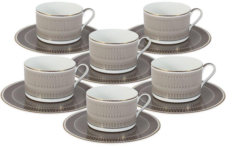 """Набор чайный Naomi """"Мокко"""" включает 6 чашек и 6 блюдец. Изделия выполнены из высококачественного костяного фарфора. Набор дополнен красивым рисунком.  Такой набор изысканно дополнит сервировку стола к чаепитию. Благодаря оригинальному дизайну и качеству исполнению набор станет полезным приобретением для кухни."""