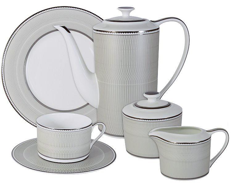 Чайный сервиз Naomi Маренго, 21 предмет, 6 персон. NG-I150905C-21-AlNG-I150905C-21-AlЧайный сервиз Маренго 21 предм.на 6 персон (6 чашек 0.25л, 6 блюдец, 6 тарелок 21.5см, чайник 1.4л, сахарница 0.35л, молочник 0.25л )Чайная и обеденная посуда торговой марки Naomi из высококачественного костяного фарфора отличается прекрасными дизайнами, исполненными как в современном, так и в классическом стиле по разработкам современных японских художников. Все изделия изготавливаются на современном оборудовании по новейшим технологиям и проходят строгий контроль качества.