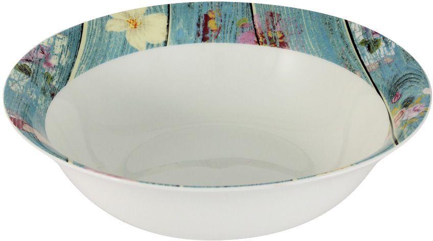Салатник Primavera Фантазия, диаметр 23 смPWW-150118-22ALСалатник Primavera Фантазия изготовлен из фарфора с добавлением костной золы (7-15%), благодаря которой фарфор получается прозрачным и прочным. Изделие легкое, белоснежное, прочное. Нанесение сверкающей глазури, не содержащей свинца, придает изделию превосходный блеск и особую прочность. Кромка изделия декорирована красочным изображением. Такой салатник отлично подойдет для сервировки салатов, закусок, солений, соусов. Он оригинально дополнит сервировку стола и станет практичным приобретением для кухни.Серия посуды Фантазия - это не просто изделие из костяного фарфора, тонкое и изящное, это декор для любителей неформального, слегка состаренного интерьера в ярких голубых тонах, с изображением потертого бруса в окружении порхающих бабочек.Посуда подходит для ежедневного использования. Благодаря отсутствию серебряной и золотой отделки посуду можно мыть в посудомоечной машине, а также использовать в микроволновой печи.