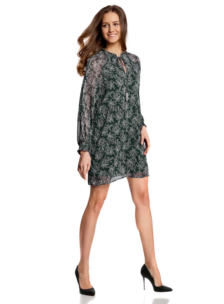 Платье oodji Ultra, цвет: темно-зеленый, белый. 11914001/15036/6912E. Размер 40-170 (46-170)11914001/15036/6912EСтильное платье oodji Ultra выполнено из качественного полиэстера. Подкладка изделия также изготовлена из полиэстера. Модное шифоновое платье-мини с круглым вырезом горловины и длинными рукавами-реглан дополнена спереди завязками. Завязки имеют на кончиках оригинальные металлические кисточки. Рукава модели дополнены манжетами на широких резинках и оригинальными прорезями вдоль рукава с завязками-бантиками. Вырез горловины оформлен нежной рюшей.