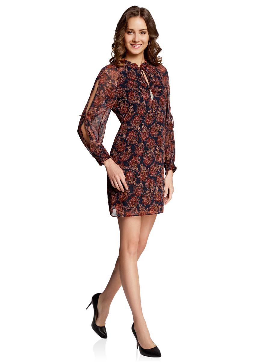 Платье oodji Ultra, цвет: темно-синий, бордовый. 11914001/15036/7949E. Размер 38-170 (44-170)11914001/15036/7949EСтильное платье oodji Ultra выполнено из качественного полиэстера. Подкладка изделия также изготовлена из полиэстера. Модное шифоновое платье-мини с круглым вырезом горловины и длинными рукавами-реглан дополнена спереди завязками. Завязки имеют на кончиках оригинальные металлические кисточки. Рукава модели дополнены манжетами на широких резинках и оригинальными прорезями вдоль рукава с завязками-бантиками. Вырез горловины оформлен нежной рюшей.