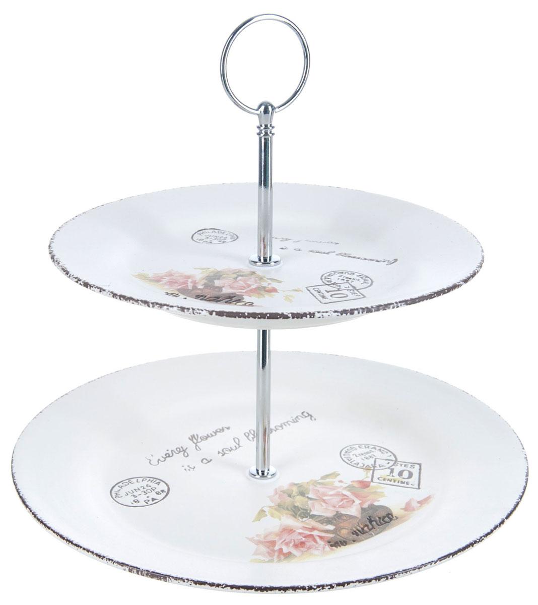 Ваза для фруктов ENS Group Чайная роза, двухъярусная. 17501661750166Двухъярусная ваза ENS Group Чайная роза, выполненная из доломитовой керамики, сочетает в себе изысканный дизайн с максимальной функциональностью. Блюда вазы украшены цветочным рисунком. Изделие предназначено для красивой сервировки фруктов. Такая ваза для фруктов придется по вкусу и ценителям классики, и тем, кто предпочитает утонченность и изящность.Ваза для фруктов украсит сервировку вашего стола и подчеркнет прекрасный вкус хозяина, а также станет отличным подарком.