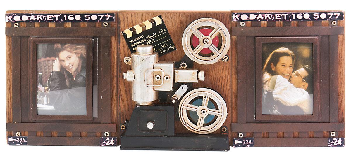Фоторамка двойная Platinum Кинопроектор Kodak, на 2 фото, 7 х 9 см. 1410F-2511410F-251Фоторамка Platinum Кинопроектор Kodak, выполненная из металла, имеет оригинальный дизайн. Она оформлена в виде кадров на кинопленке и декорирована кинопроектором . Рамка предназначена для размещения двух фотографий. Такая фоторамка поможет вам оригинально и стильно дополнить интерьер помещения, а также позволит сохранить память о дорогих вам людях и интересных событиях вашей жизни.Подходит длядвух фотографий размером: 7 х 9 см.