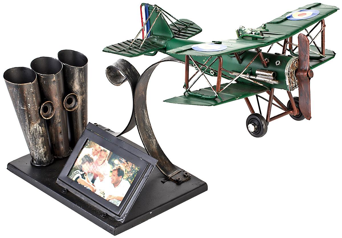 Фоторамка Platinum Аэроплан, с подставкой для ручек, 5 х 7 см1404E-4466Фоторамка Platinum Аэроплан, выполненная из металла, имеет оригинальный дизайн. Она оснащена подставкой для ручек, которая освобождает пространство на вашем столе. Такая фоторамка поможет вам оригинально и стильно дополнить интерьер помещения, а также позволит сохранить память о дорогих вам людях и интересных событиях вашей жизни.Подходит для фотографий размером: 5 х 7 см.