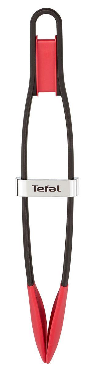 Кулинарные Щипцы Tefal Ingenio, цвет: черный, красныйK2060714Кулинарные Щипцы Tefal Ingenio - непревзойденная простота и производительность.Изделие выполнено из высококачественного пластика и силикона, за счет чего обеспечивается его долговечность, практичность и легкость эксплуатации. Щипцы имеют небольшие размеры: длина: 42 см ширина: 14 смвысота: 4,5 см.Этот кухонный аксессуар позволяет с легкостью перекладывать холодные, горячие продукты на сковороду и со сковороды, вытаскивать ингредиенты из кипящей воды. Можно мыть в посудомоечной машине.