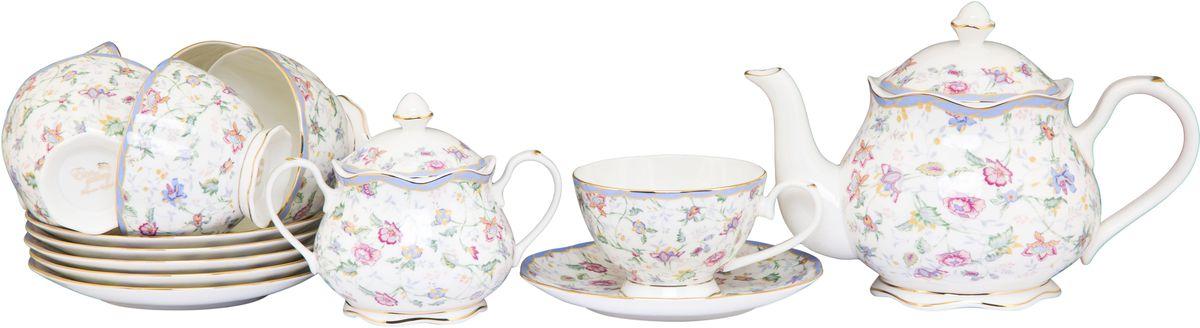 """Чайный набор Elan Gallery """"Цветочный каприз"""" состоит из 6 чашек и 6 блюдец, заварочного  чайника и сахарницы. Чайник снабжен удобной ручкой и  широким носиком. В основании носика расположены фильтрующие отверстия от попадания  чаинок в чашку. Сахарница оснащена крышкой и  удобными ручками. Изделия, выполненные из высококачественной керамики, имеют  элегантный дизайн и классическую форму.  Такой набор прекрасно подойдет как для повседневного использования, так и для  праздников.  Чайный набор Elan Gallery """"Цветочный каприз"""" - это не только яркий и полезный подарок  для родных и близких, а также великолепное решение  для вашей кухни или столовой.  Не рекомендуется применять абразивные моющие средства. Не использовать в  микроволновой печи. Объем чашки: 250 мл.  Объем заварного чайника: 1,1 л. Объем сахарницы: 430 мл."""