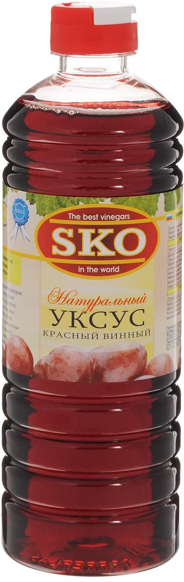 SKO уксус натуральный красный винный, 500 мл13006Красный винный уксус произведен из натуральных испанских вин. 100% натуральный продукт.Без искусственных красителей и ароматизаторов. Красный винный уксус SKO - прекрасная заправка для салатов из овощей и фруктов, а также для приготовления блюд из мяса, рыбы, птицы и приготовления соусов.Обогащает вкус блюда, очищает кровеносные сосуды, укрепляет иммунную систему, выводит из организма шлаки, регулирует обмен веществ.