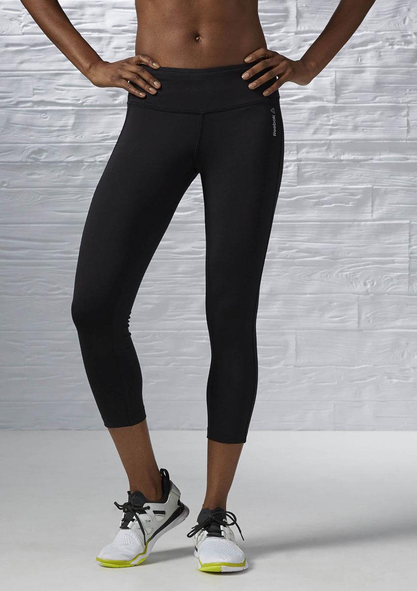 Капри женские для фитнеса Reebok Wor PP 34 Cap Lr, цвет: черный. AJ3316. Размер M (46/48)AJ3316Капри - идеальный вариант для тех, кто находится в поисках оптимального сочетания функциональности и стиля. Они отлично тянутся, сидят по фигуре и отводят влагу, что делает их незаменимым предметом любого гардероба. Спортивный облегающий силуэт повторяет контуры вашей фигуры, обеспечивая максимальную поддержку при выполнении интенсивных упражнений. Технология Speedwick отводит влагу с поверхности тела, оставляя ощущение сухости и комфорта. Немного заниженная посадка для комфорта. Внутренний кармашек отлично подходит для хранения мелочей.