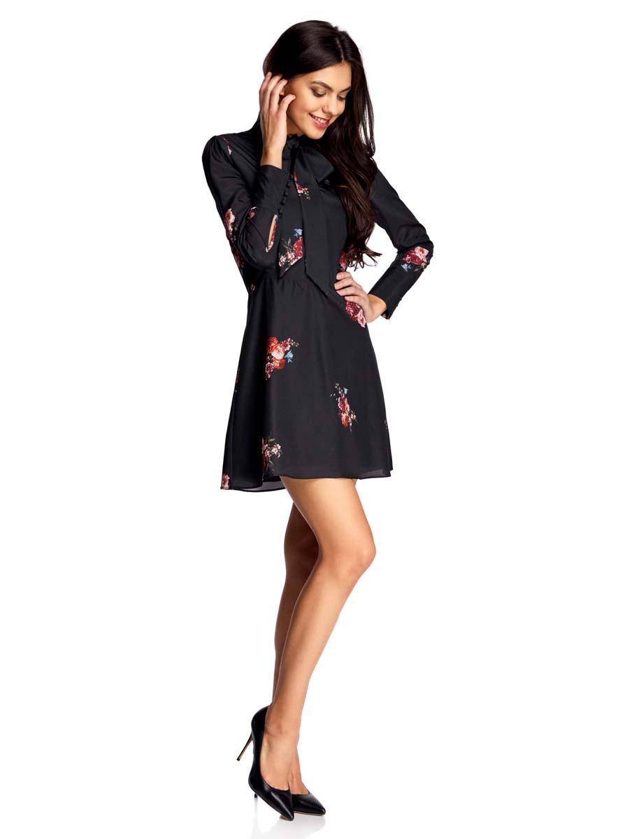 Платье oodji Ultra, цвет: черный, красный. 11913031/26546/2945F. Размер 36-170 (42-170)11913031/26546/2945FПлатье oodji Ultra полностью выполнено из полиэстера. Модель с воротником-аскот, плечиками идлинными рукавами застегивается на скрытую застежку-молнию сбоку и пуговицы, скрытые планкой на лицевой стороне в верхней части. Рукава дополнены манжетами с пуговицами на петлях. Платье оформлено цветочным принтом.