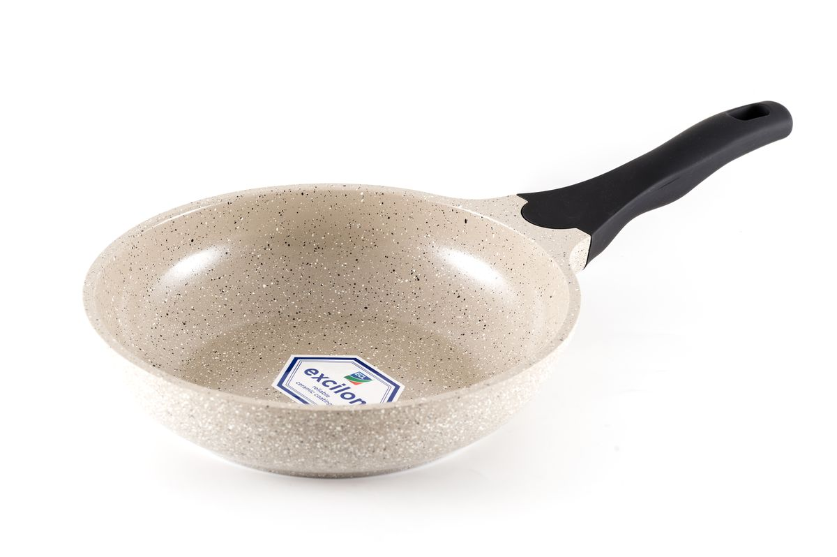 Сковорода Gipfel Stone, с мраморным покрытием. Диаметр 20 см2486Сковорода Gipfel Stone изготовлена из высококачественного алюминия с мраморным покрытие. Такое покрытием предотвращает пригорание пищи и ее прилипание к стенкам. Оно абсолютно безопасно для здоровья и не выделяет вредных веществ во время готовки.Тепло распределяется равномерно по всей поверхности посуды, что позволяет пище готовиться быстрее. Изделие снабжено удобной эргономичной ручкой из бакелита. Посуда подходит для использования на всех видах плит, включая индукционные. Можно мыть в посудомоечной машине. Высота стенки: 5,5 см.Диаметр сковороды (по верхнему краю): 20 см.