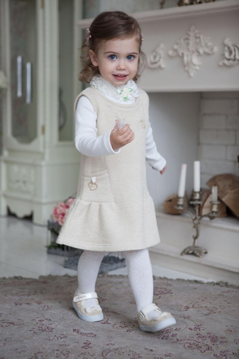 Водолазка для девочки Lucky Child Маленькая леди, цвет: молочный. 53-26. Размер 128/13453-26Маленькая принцесса с раннего детства должна быть похожа на свою стильную маму. В этой кофточке от Lucky Child ваша юная леди всегда будет выглядеть элегантно. Нежные бутоньерки-розочки из лент придают особый праздничный блеск. Трикотажная ткань из 100% хлопка обладает невероятной мягкостью и заботится о нежной коже вашего ребенка. Любой наряд в сочетании с данной кофтой приобретет благородное звучание.