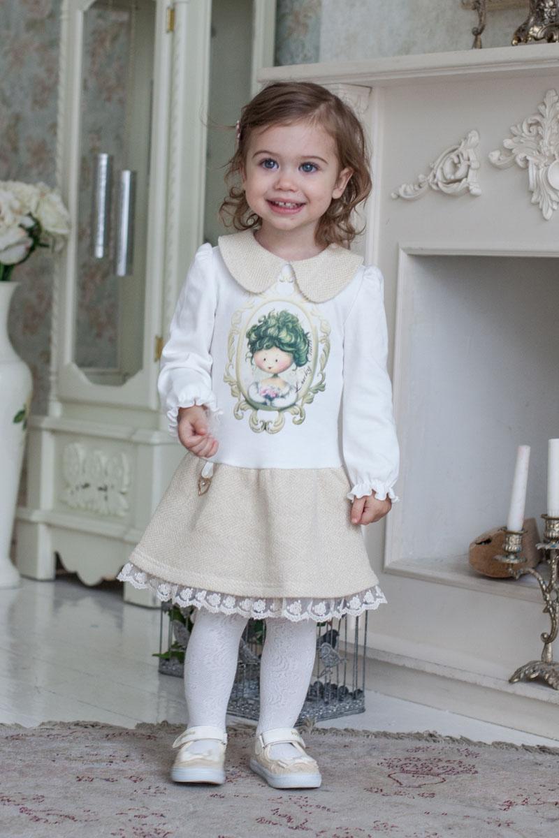 Платье для девочки Lucky Child Маленькая леди, цвет: молочный, золотой. 53-63. Размер 116/12253-63Каждая девочка мечтает стать принцессой. Какая принцесса в своих фантазиях не будет представлять себя в прекрасном наряде? Позолоченный футер в сочетании с интерлоком (трикотажная ткань из 100% хлопка) обладает невероятной мягкостью и бережно заботится о детской коже. Небольшое присутствие золотой металлизированной нити (люрекса) добавляет особое благородство наряду. Сердечко, украшающее юбку, придает наряду праздничный блеск, рукава со сборками – элегантность. В платье от Lucky Child юная принцесса каждый день будет в центре внимания.