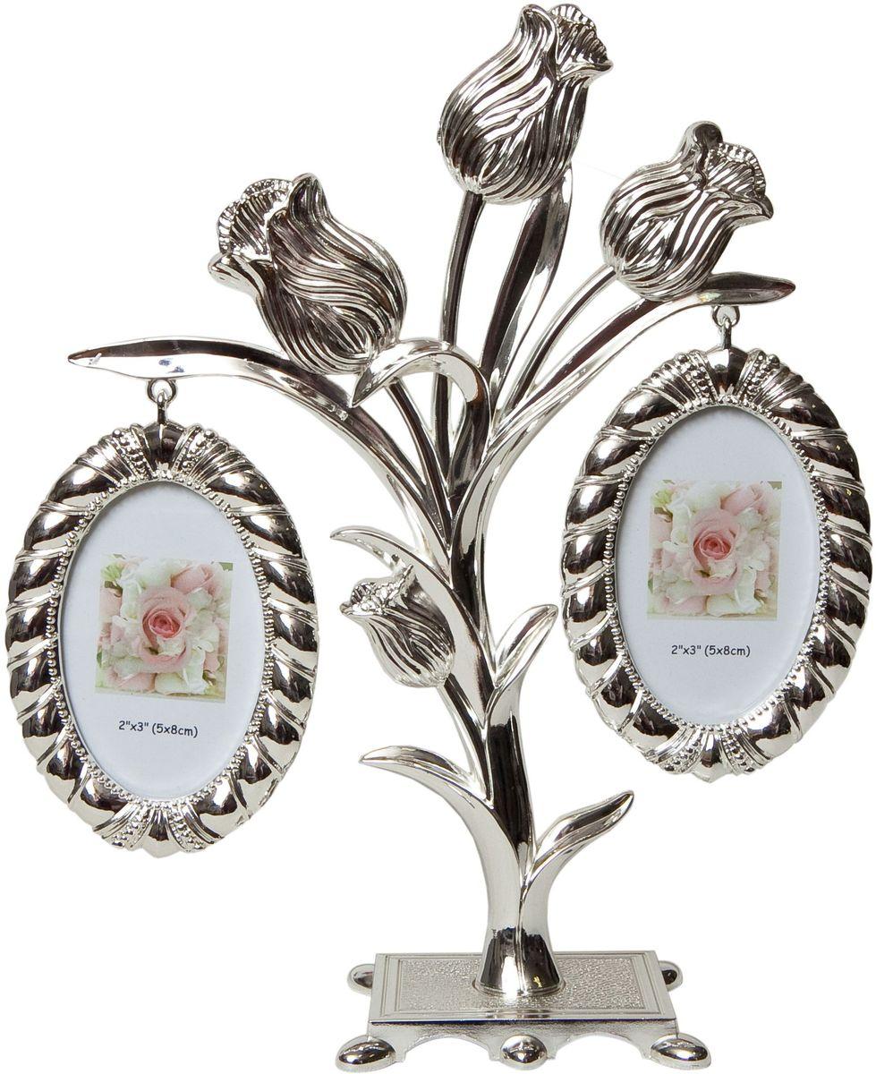 Фоторамка Platinum Дерево. Цветы, цвет: светло-серый, на 2 фото, 5 x 8 см. PF96762 фоторамки на дереве PF9676Декоративная фоторамка Platinum Дерево. Цветы выполнена из металла. На подставке в виде цветов подвешиваются две овальные рамочки. Изысканная и эффектная, эта потрясающая рамочка покорит своей красотой и изумительным качеством исполнения. Фоторамка Platinum Дерево. Цветы не только украсит интерьер помещения, но и поможет разместить фото всей вашей семьи.Высота фоторамки: 20 см.Фоторамка подходит для фотографий 5 x 8 см. Общий размер фоторамки: 18 х 4 х 20 см.