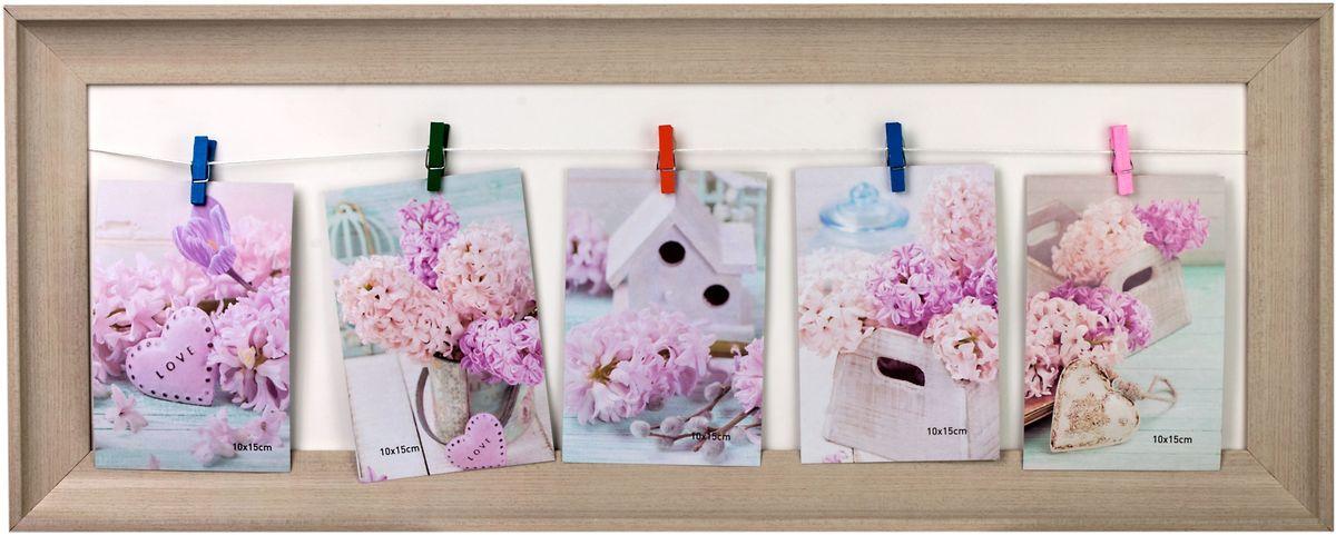 Фоторамка Platinum, на прищепках, цвет: бежевый, на 5 фото 10 х 15 смBIN-521786-5, 5 фото на прищепкахФоторамка Platinum - прекрасный способ красиво оформить ваши фотографии. Фоторамка выполнена из пластика.Фоторамка-коллаж представляет собой рамку с прищепками для фото. Такая фоторамка поможет сохранить в памяти самые яркие моменты вашей жизни, а стильный дизайн сделает ее прекрасным дополнением интерьера комнаты.Фоторамка подходит для фотографий 10 х 15 см. Общий размер фоторамки: 67,5 х 27 см.