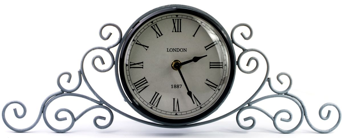Часы настольные Miralight, цвет: серый. ML-5111ML-5111 Antique grey Часы настольные серыеНастольные часы Miralight, изготовленные из металла, прекрасно украсят интерьер вашего помещения. Часы, выполненные в модном стилеретро, имеют кованую ажурную подставку для удобного размещения на столе и массивный металлический корпус. Состаренный циферблат круглой формы имеет две стилизованныефигурные стрелки: часовую и минутную и элегантные римские цифры. Питание осуществляется от одной батарейки типа АА (не входит в комплект).Оформите свой дом таким интерьерным аксессуаром или преподнесите его в качестве презента друзьям, и они оценят ваш оригинальный вкус инеординарность подарка.