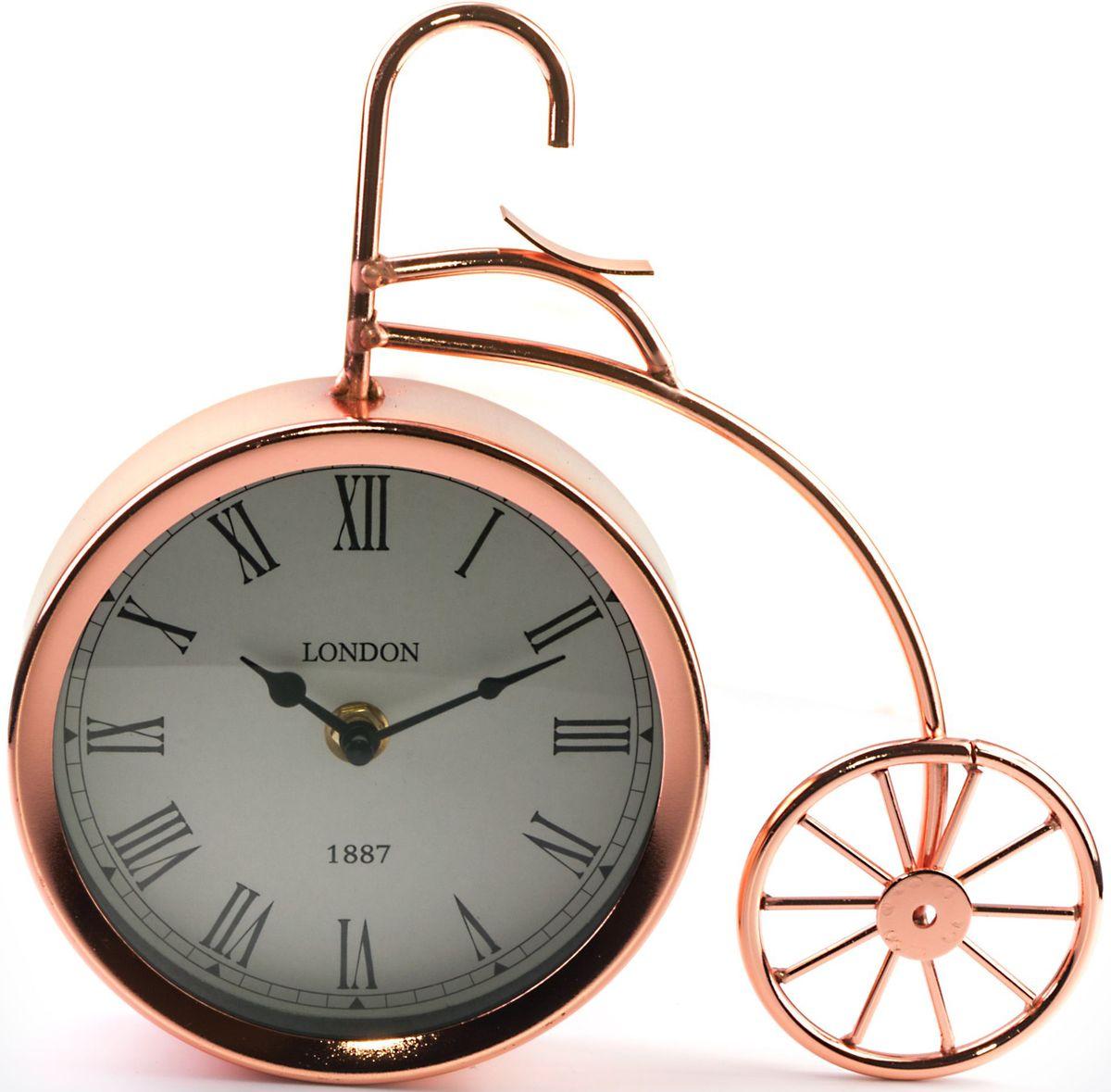 Часы настольные Miralight Велосипед, цвет: медныйML-5379 Copper Часы настольные Велосипед медный большойНастольные часы Miralight Велосипед, изготовленные из металла, прекрасно украсят интерьер вашего помещения. Часы выполнены в виде старинного двухколесного велосипеда. Циферблат круглой формы имеет две стилизованные фигурные стрелки: часовую и минутную и элегантные римские цифры. Питание осуществляется от одной батарейки типа АА (не входит в комплект).Оформите свой дом таким интерьерным аксессуаром или преподнесите его в качестве презента друзьям, и они оценят ваш оригинальный вкус инеординарность подарка.