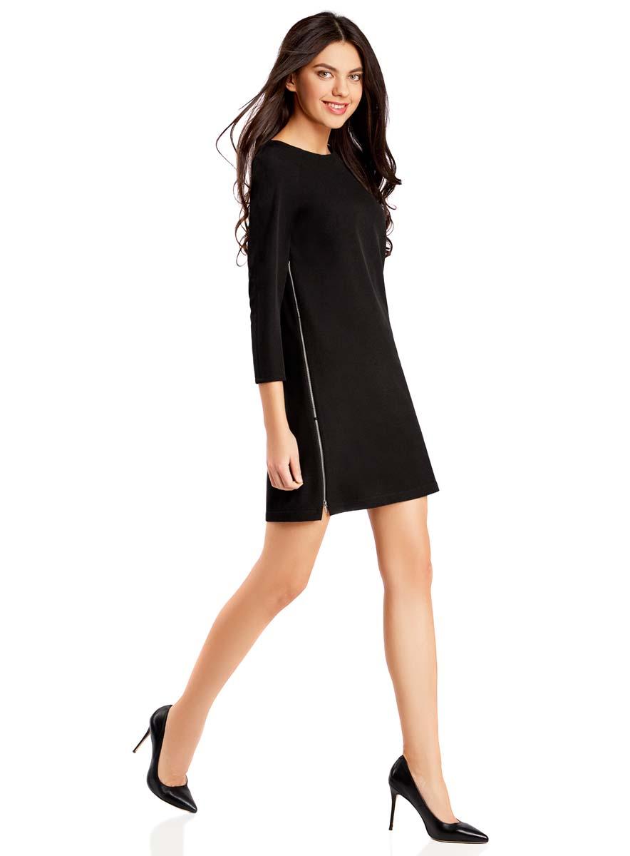 Платье oodji Ultra, цвет: черный. 11914002/42354/2900N. Размер 42-170 (48-170)11914002/42354/2900NОригинальное платье прямого кроя oodji Ultraвыполнено из качественного трикотажа. Модель мини-длины с рукавами 3/4 и круглым вырезом горловинызастегивается на короткую молнию на спинке. По бокам платье дополнено декоративными молниями во всю длину.