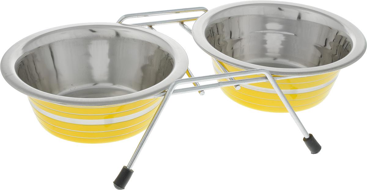 Миска для животных VM, двойная, на подставке, цвет: желтый, стальной, 480 мл, 2 штVM-3000 (B)Двойная миска VM - это функциональный аксессуар для животных. Изделие состоит из двух мисок, выполненных из высококачественного металла. Миски размещены на подставке с резиновыми колпачками на ножках. Яркий дизайн придаст изделию индивидуальность и удовлетворит вкус самых взыскательных зоовладельцев. Объем одной миски: 480 мл. Внутренний диаметр миски: 11,5 см. Высота миски: 4,5 см. Размер подставки: 27 х 17 х 7 см.