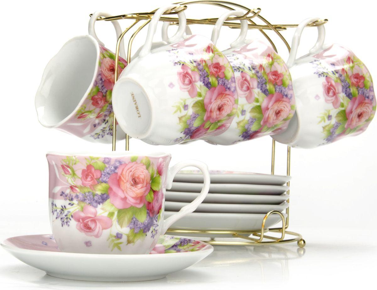 Сервиз чайный Loraine, на подставке, 13 предметов. 4328025936Чайный набор состоит из шести чашек, шести блюдец и металлической подставки золотого цвета. Предметы набора изготовлены из качественного фарфора и оформлены красочным цветным рисунком, стенки чашек имеют изящную волнистую поверхность. Чайный набор идеально подойдет для сервировки стола и станет отличным подарком к любому празднику. Все изделия можно компактно хранить на подставке, входящей в набор. Подходит для мытья в посудомоечной машине.Диаметр чашки: 8 см.Высота чашки: 7 см.Объем чашки: 200 мл.Диаметр блюдца: 13,5 см.