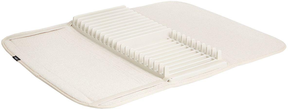Коврик для сушки посуды Umbra Udry, цвет: молочный330720-354Коврик для сушки посуды Umbra Udry - функциональный предмет 2-в-1, в котором объединены коврик и подставка для сушки посуды. Коврик удобен для сушки чашек, стаканов и глубоких мисок, а подставка - для тарелок и блюдец. Изделие разбирается для удобной чистки. Для хранения компактно складывается и закрепляется с помощью эластичных завязок. Размеры в разложенном виде: 61 x 45,8 x 2,5 см.