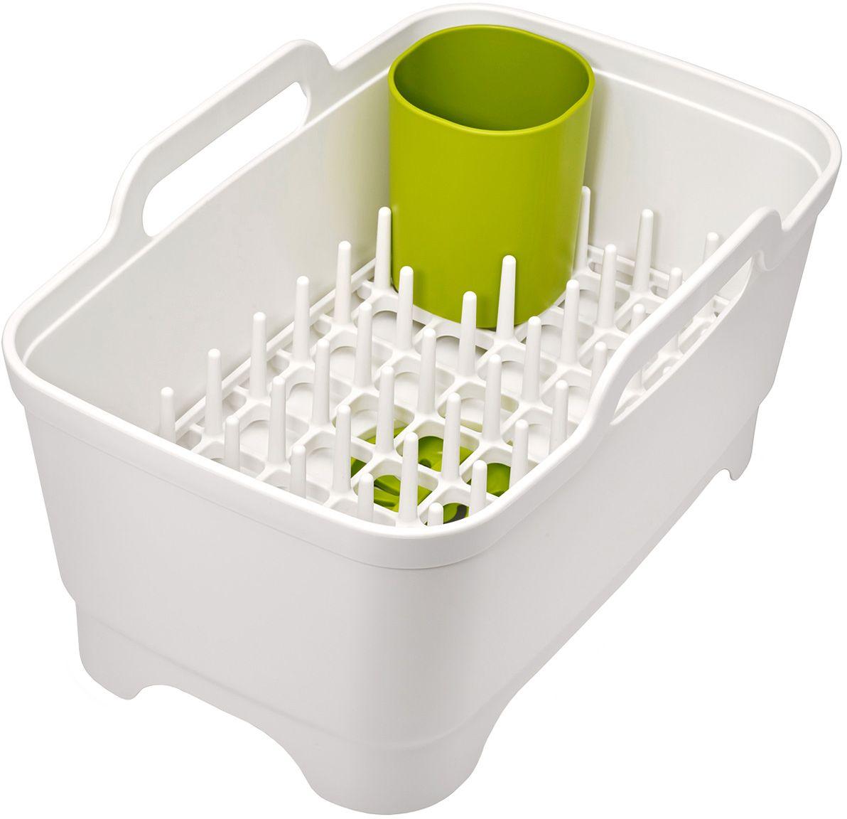 Набор для мойки и сушки посуды Joseph Joseph, цвет: белый85101Набор для мойки и сушки посуды Joseph Joseph включает в себя тазик для мытья, со встроенной пробкой для слива/удержания воды и съемную сушилку для посуды и столовых приборов. Компактный и функциональный дизайн, который поможет по максимуму использовать существующее пространство: подставка для посуды может использоваться как внутри таза, так и на рабочей поверхности. Сам тазик оснащен удобными широкими ручками для переноски, его размеры идеально впишутся в любую раковину.Моется вручную.