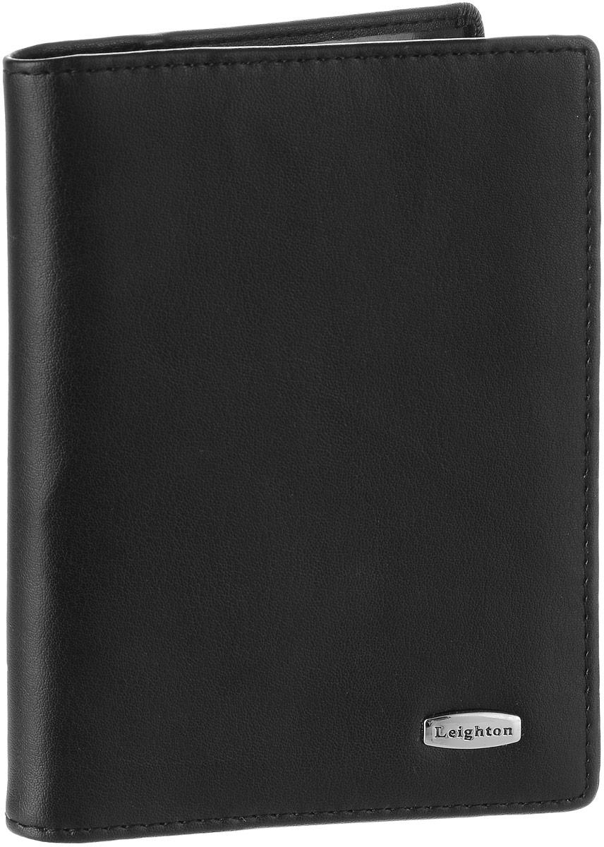 Обложка для автодокументов женская Leighton, цвет: черный. 221322136 чернЖенская обложка для автодокументов Leighton выполнена из натуральной кожи.Изделие раскладывается пополам. Обложка содержит съемный блок из шести прозрачных файлов из мягкого пластика, один из которых формата А5 и два боковых прозрачных кармана.Изделие упаковано в фирменную коробку.Модная обложка для автодокументов поможет сохранить их внешний вид и защитить от повреждений.