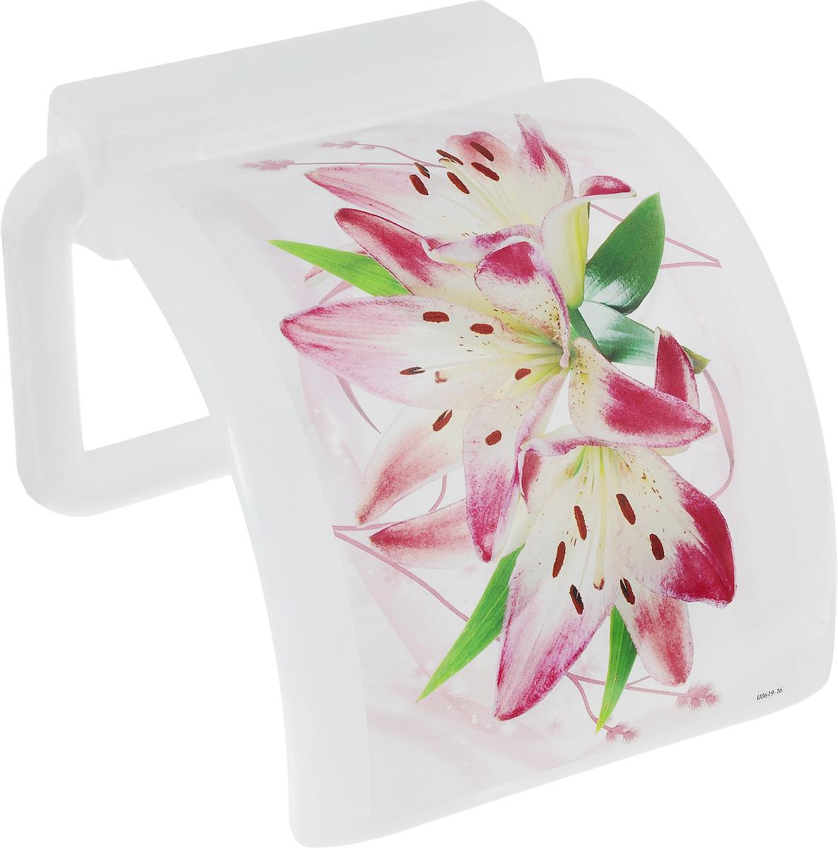 """Держатель для туалетной бумаги Idea """"Деко. Лилия"""" изготовлен из прочного пластика и оснащен крышкой.  На задней стенке изделия имеются 2 отверстия для подвешивания.  Размер держателя: 15 х 13 х 9 см."""