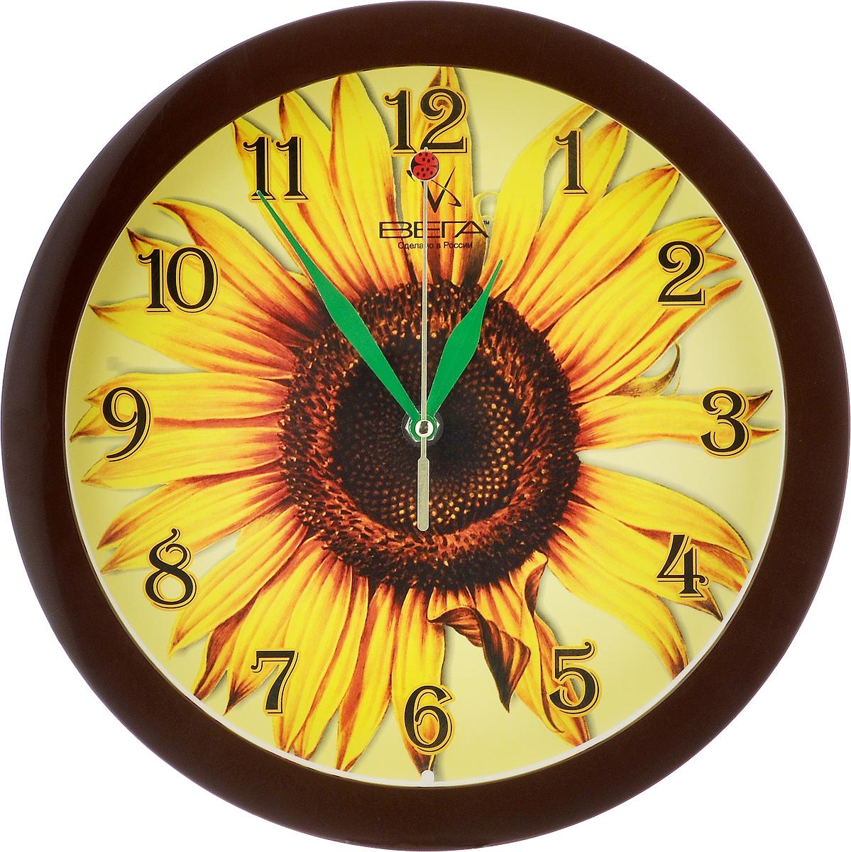 Часы настенные Вега Подсолнух, диаметр 28,5 смП1-9/7-15Настенные кварцевые часы Вега Подсолнух, изготовленные из пластика, прекрасно впишутся в интерьервашего дома. Круглые часы имеют три стрелки: часовую,минутную и секундную, циферблат защищен прозрачным стеклом.Часы работают от 1 батарейки типа АА напряжением 1,5 В (не входит в комплект).Диаметр часов: 28,5 см.