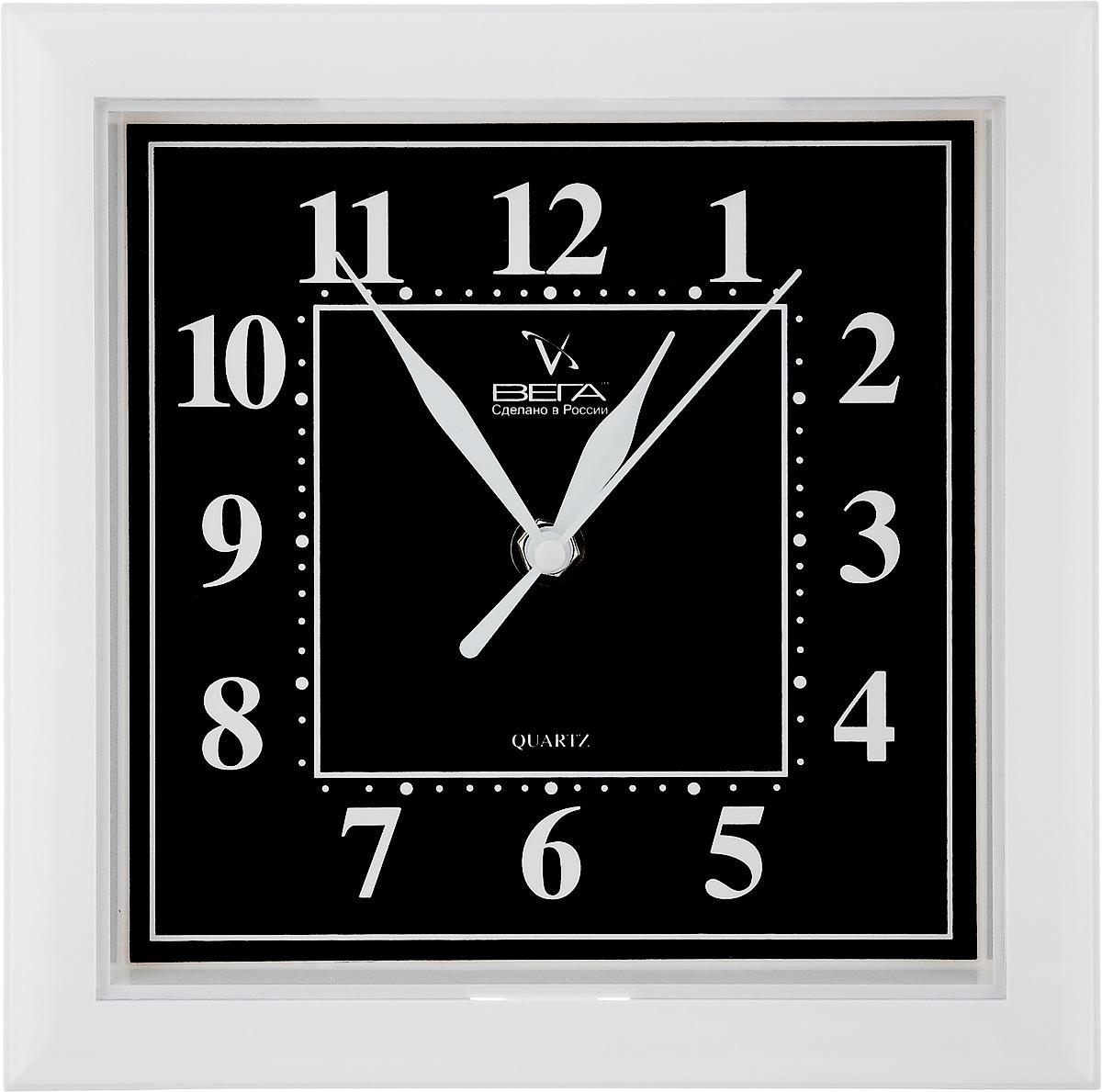 Часы настенные Вега Классика, цвет: белый, черный, 20,6 х 20,6 х 4 смП3-7-48Настенные кварцевые часы Вега Классика в классическом дизайне,изготовленные из пластика, прекрасно впишутся в интерьервашего дома. Квадратные часы имеют три стрелки: часовую,минутную и секундную, циферблат защищен прозрачнымпластиком.Часы работают от 1 батарейки типа АА напряжением 1,5 В (не входит в комплект).