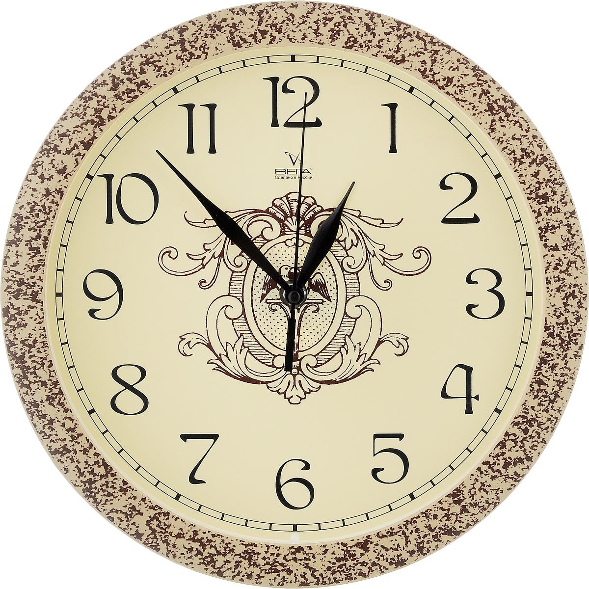 Часы настенные Вега Классика, цвет: бежевый, коричневый, диаметр 28,5 см. П1-1492/7П1-1492/7-66Настенные кварцевые часы Вега Классика, изготовленные из пластика, прекрасно впишутся в интерьер вашего дома. Круглые часы имеют три стрелки: часовую, минутную и секундную, циферблат защищен прозрачным стеклом. Часы работают от 1 батарейки типа АА напряжением 1,5 В (не входит в комплект). Диаметр часов: 28,5 см.
