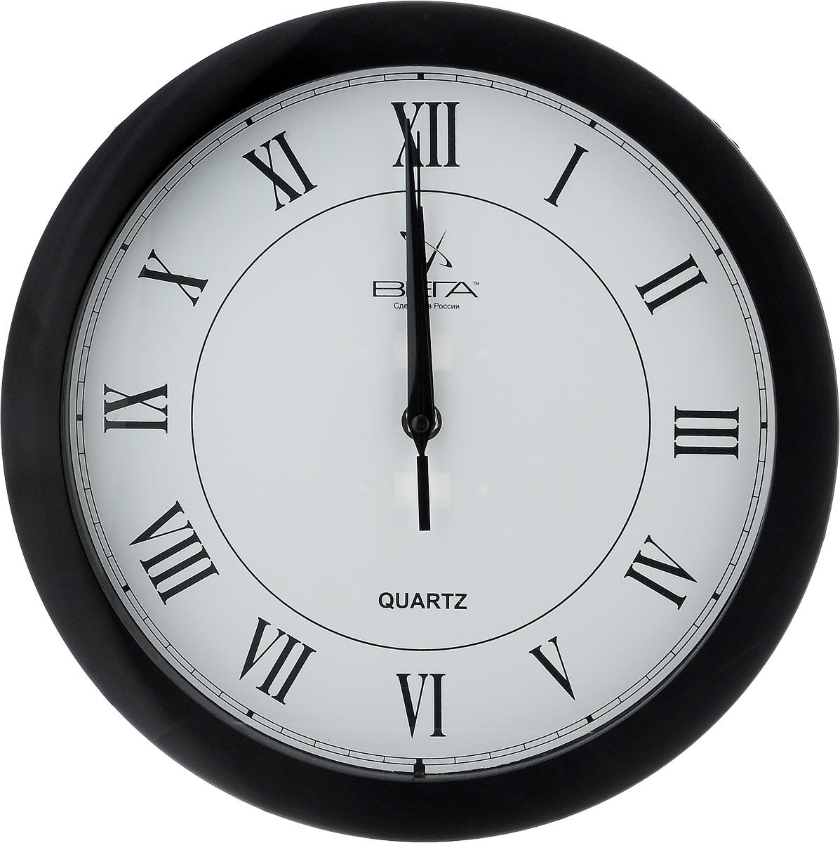 Часы настенные Вега Римская классика, цвет: черный, белый, диаметр 28,5 смП1-6/6-47Настенные кварцевые часы Вега Римская классика, изготовленные из пластика, прекрасно впишутся в интерьер вашего дома. Круглые часы имеют три стрелки: часовую, минутную и секундную, циферблат защищен прозрачным стеклом. Часы работают от 1 батарейки типа АА напряжением 1,5 В (не входит в комплект). Диаметр часов: 28,5 см.