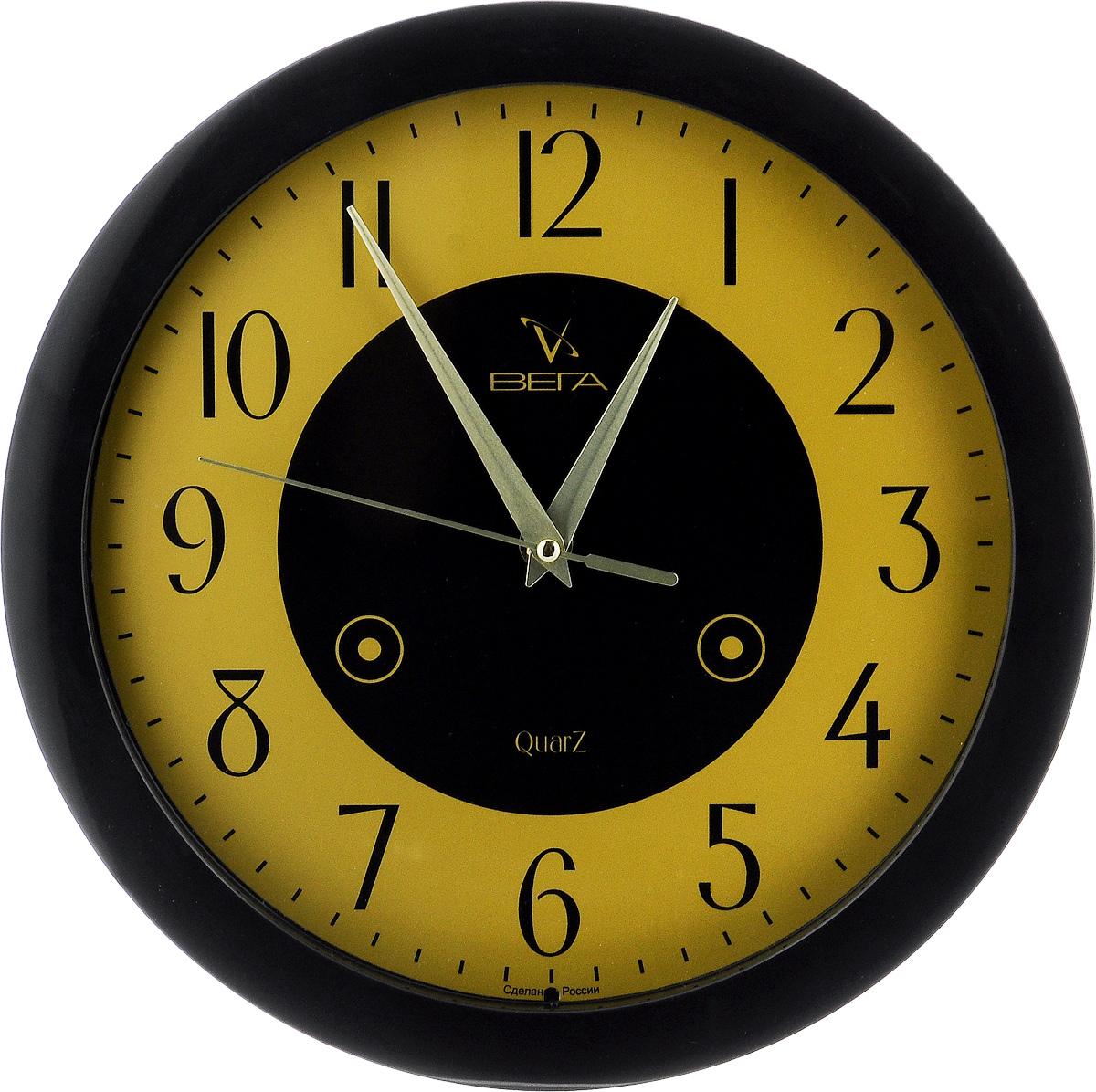 Часы настенные Вега Классика, цвет: черный, желтый, диаметр 28,5 см. П1-6/6П1-6/6-16Настенные кварцевые часы Вега Классика, изготовленные из пластика, прекрасно впишутся в интерьервашего дома. Круглые часы имеют три стрелки: часовую,минутную и секундную, циферблат защищен прозрачным стеклом.Часы работают от 1 батарейки типа АА напряжением 1,5 В (не входит в комплект).Диаметр часов: 28,5 см.
