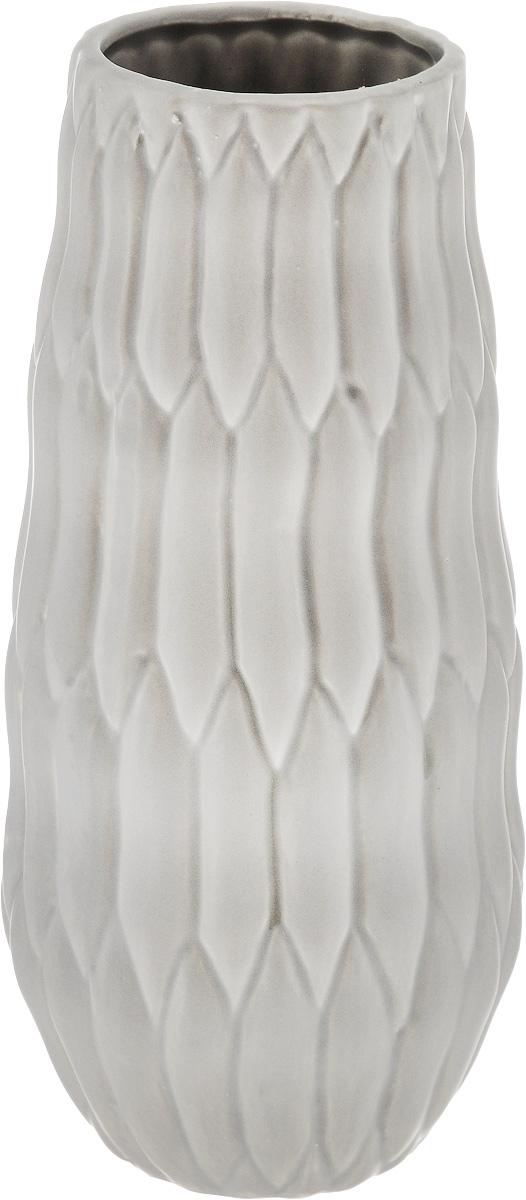 Ваза декоративная Феникс-Презент, высота 22,3 см43827Оригинальная ваза Феникс-Презент изготовлена из фаянса. Рельефная поверхностью вазы делает ее изящным украшением интерьера. При желании изделие можно оформить по собственному вкусу, например раскрасив его красками. Ваза Феникс-Презент дополнит интерьер офиса или дома и станет желанным и стильным подарком.Диаметр вазы по верхнему краю: 7 см.Диаметр дна: 6 см. Высота вазы: 22,3 см.