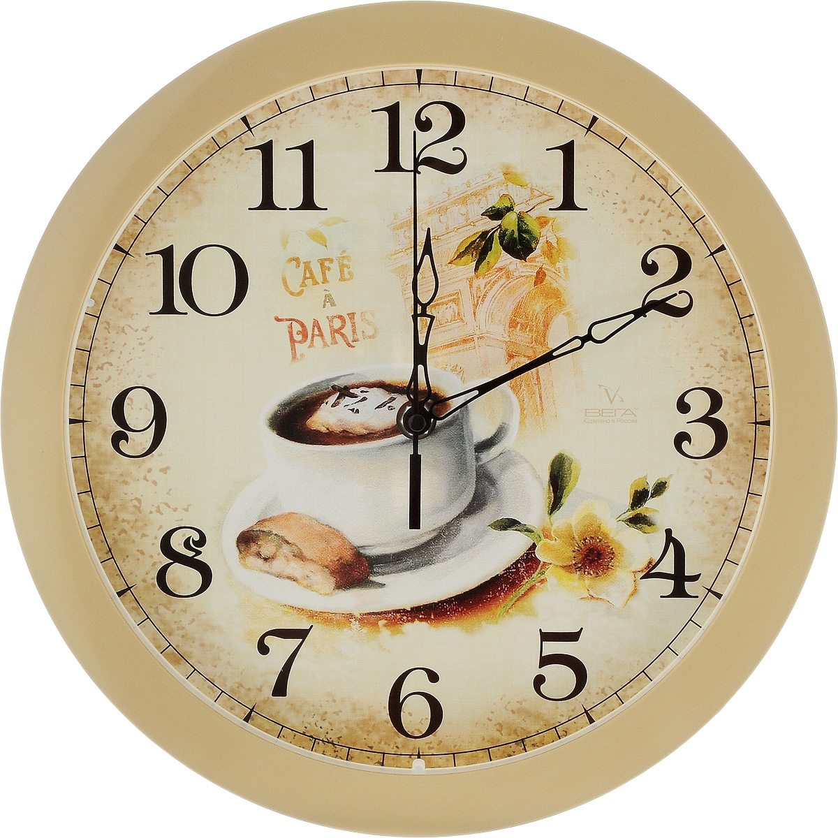 """Настенные кварцевые часы Вега """"Французский завтрак"""",  изготовленные из пластика, прекрасно впишутся в интерьер  вашего дома. Часы имеют три стрелки: часовую, минутную и  секундную, циферблат защищен прозрачным стеклом.  Часы работают от 1 батарейки типа АА напряжением 1,5 В (не  входит в комплект). Диаметр часов: 28,5 см."""