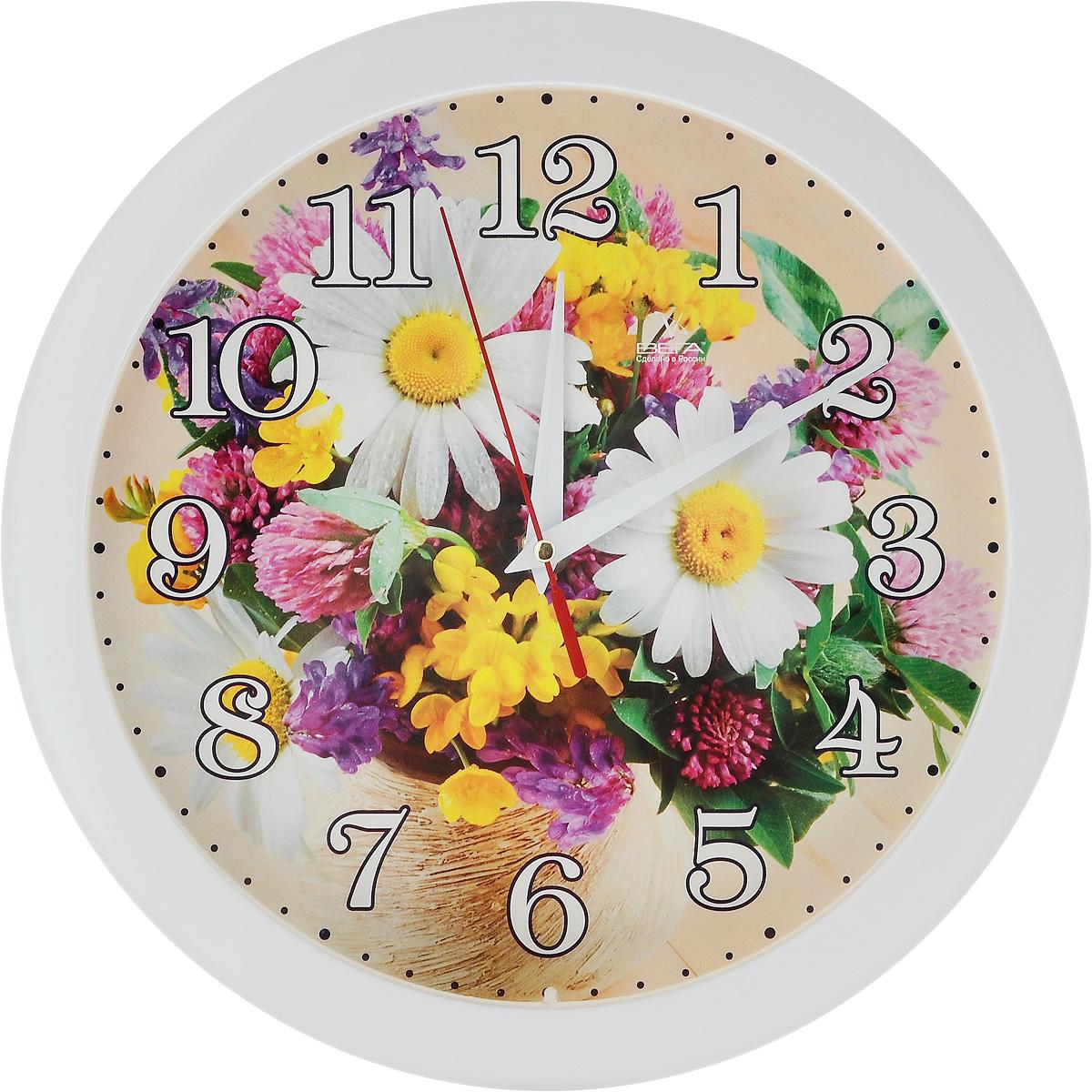 Часы настенные Вега Маринина радость, диаметр 28,5 смП1-7/7-219Настенные кварцевые часы Вега Маринина радость,изготовленные из пластика, прекрасно впишутся в интерьервашего дома. Часы имеют три стрелки: часовую, минутную исекундную, циферблат защищен прозрачным стеклом.Часы работают от 1 батарейки типа АА напряжением 1,5 В (невходит в комплект). Диаметр часов: 28,5 см.