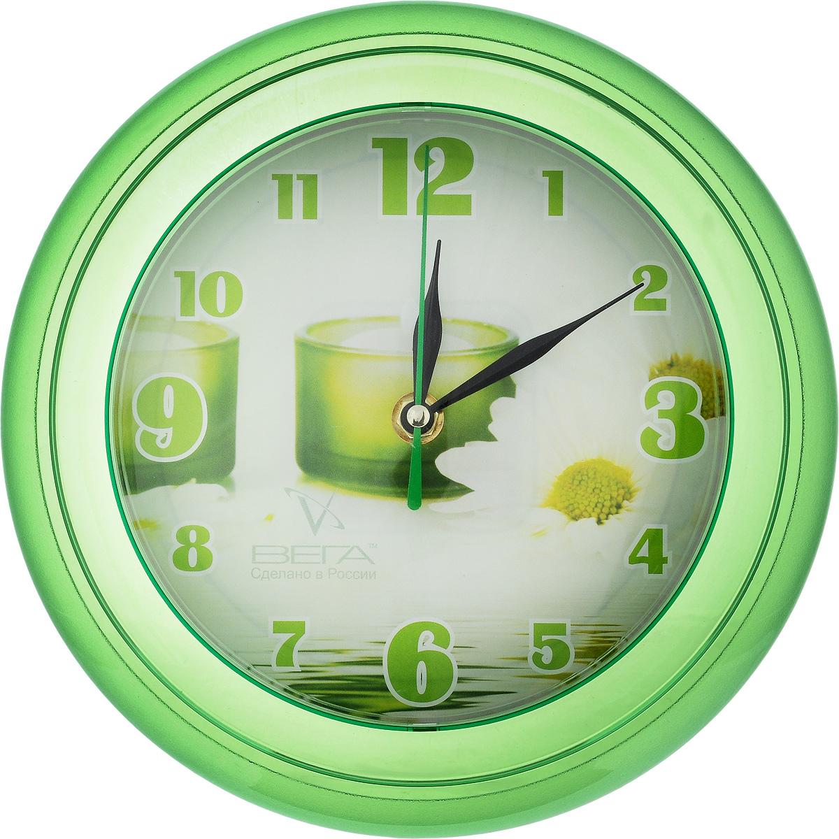 Часы настенные Вега Свеча зеленая, диаметр 22 смП6-3-10Настенные кварцевые часы Вега Свеча зеленая, изготовленные из пластика, прекрасно впишутся в интерьер вашего дома. Круглые часы имеют три стрелки: часовую, минутную и секундную, циферблат защищен прозрачным стеклом.Часы работают от 1 батарейки типа АА напряжением 1,5 В (не входит в комплект).Диаметр часов: 22 см.