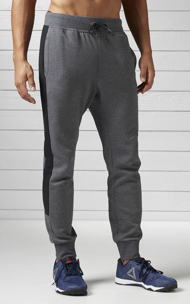 Брюки спортивные мужские Reebok Wor C Graphic Trackpant, цвет: серый. BK4731. Размер S (44/46) весенние куртки reebok мужские