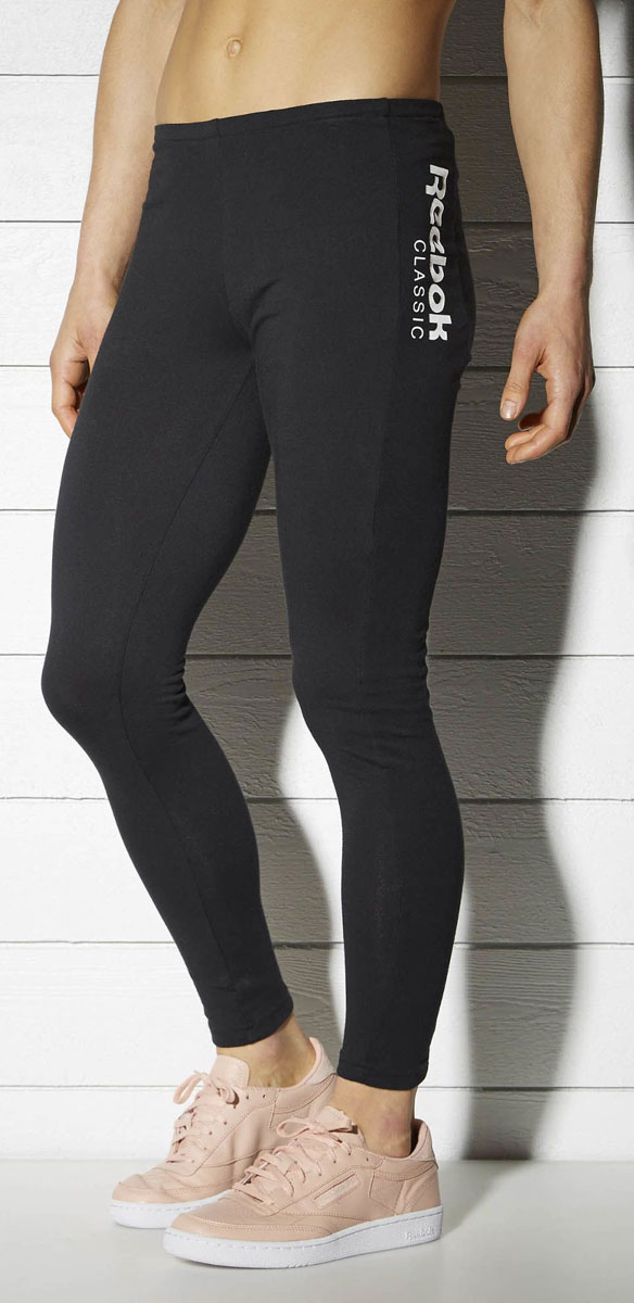 Леггинсы женские Reebok F Fitness Leggings, цвет: черный. BK4150. Размер XL (52/54)BK4150Леггинсы Reebok F Fitness Leggings выполнены из высококачественного материала. Модель с контрастными деталями идеально дополнит ваш фитнес-гардероб. Леггинсы слегка укороченного кроя дополнены эластичным поясом для идеальной посадки и оформлены логотипом Reebok Classic.