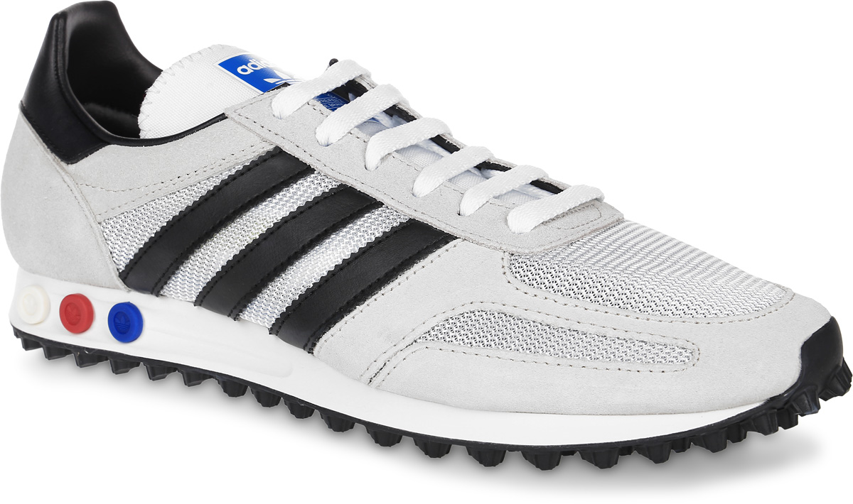 Кроссовки мужские adidas Originals La Trainer Og, цвет: светло-серый, черный. BB1206. Размер 11,5 (45)BB1206Мужские кроссовки adidas Originals La Trainer Og выполнены из натуральной кожи разной текстуры и текстиля. Модель оформлена фирменными нашивками. Шнурки надежно зафиксируют модель на ноге. Кроссовки оснащены системой с регулировкой амортизации задней части стопы. Внутренняя поверхность из сетчатого текстиля комфортна при движении. Стелька выполнена из легкого ЭВА-материала с поверхностью из текстиля. Подошва изготовлена из высококачественной резины и дополнена протектором.