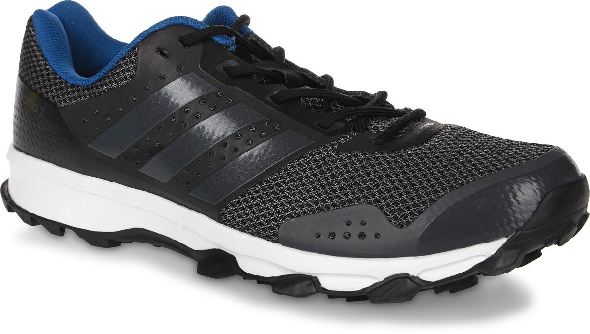 Кроссовки для бега мужские adidas Duramo 7 Trail, цвет: темно-серый, черный. BB4430. Размер 9,5 (42,5)BB4430Мужские кроссовки для бега adidas Duramo 7 Trail выполнены из сетчатого текстиля и оформлены фирменными накладками из полимера. Шнурки надежно зафиксируют модель на ноге. Внутренняя поверхность из текстиля комфортна при движении. Стелька выполнена из легкого ЭВА-материала с поверхностью из текстиля. Подошва изготовлена из высококачественной резины и дополнена рельефным рисунком. Задняячасть подошвы оснащена вставкой из Adiprene, которая смягчает ударную нагрузку на стопу и обеспечивает дополнительную амортизацию.