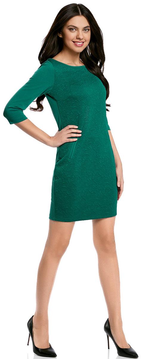 Платье oodji Collection, цвет: темно-изумрудный. 24001100-4/46435/6E00N. Размер L (48-170)24001100-4/46435/6E00NПлатье oodji Collection, выгодно подчеркивающее достоинства фигуры, выполнено из плотного фактурного трикотажа. Модель средней длины с вырезом лодочкой и рукавами 3/4 дополнена двумя прорезными карманами на юбке.
