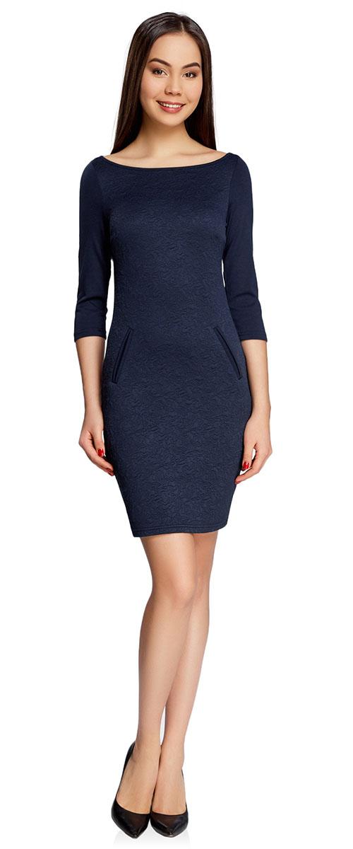 Платье oodji Collection, цвет: темно-синий. 24001100-4/46435/7900N. Размер M (46-170)24001100-4/46435/7900NПлатье oodji Collection, выгодно подчеркивающее достоинства фигуры, выполнено из плотного фактурного трикотажа. Модель средней длины с вырезом лодочкой и рукавами 3/4 дополнена двумя прорезными карманами на юбке.