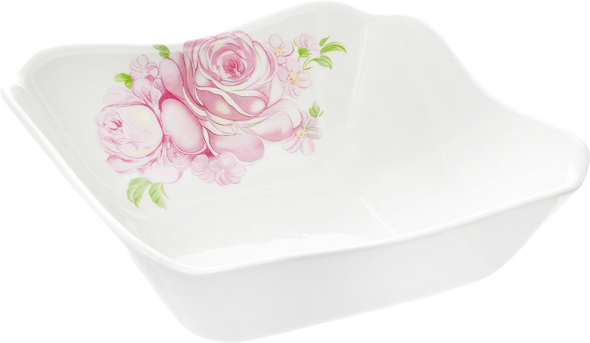 Салатник Кубаньфарфор Розовые розы, 18,5 х 18,5 см049_Розовые розыСалатник Кубаньфарфор Розовые розы изготовлен из высококачественного фаянса. Он украшен изысканным рисунком. Такой салатник сочетает в себе изысканный дизайн с максимальной функциональностью. Он идеально подходит для сервировки стола и подачи закусок, солений, салатов и других блюд. Такой салатник прекрасно впишется в интерьер вашей кухни и станет достойным подарком к любому празднику.Размер салатника (по верхнему краю): 18,5 х 18,5 см.Размер основания салатника: 10 х 10 см.Высота салатника: 6 см.
