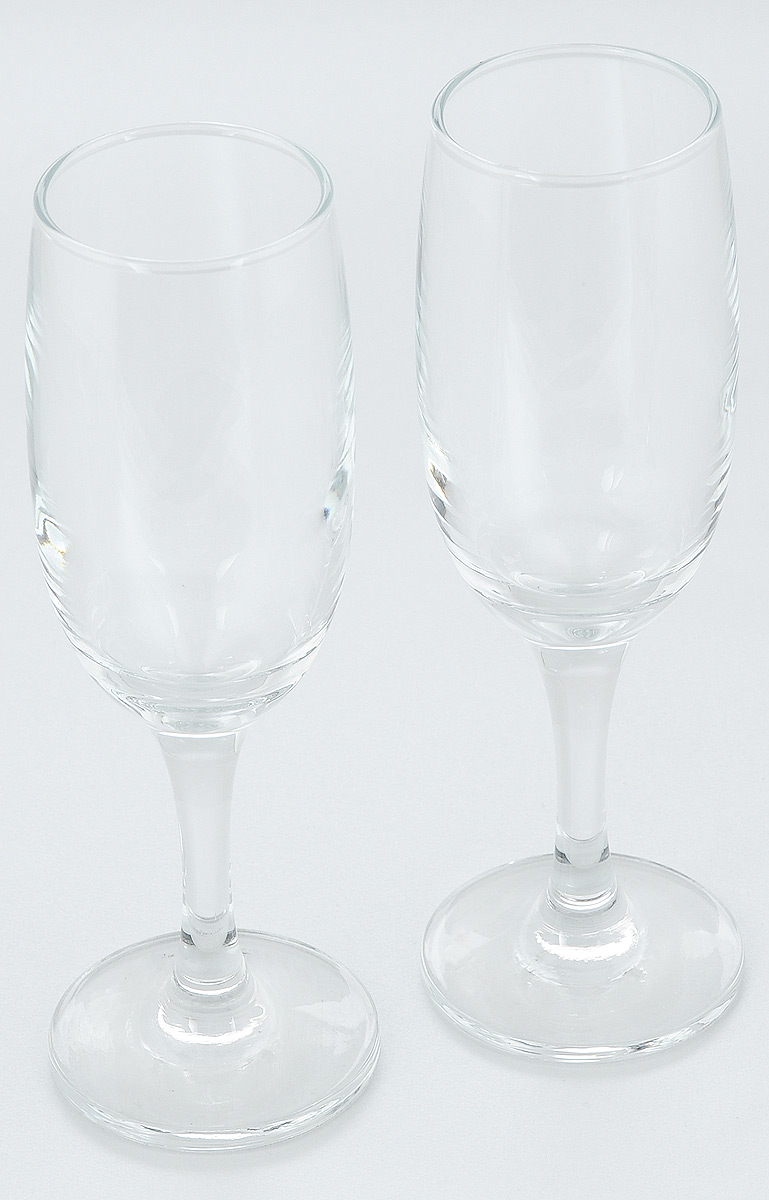 """Набор Pasabahce """"Bistro"""" состоит из двух бокалов, выполненных из прочного натрий-кальций-силикатного стекла. Изделия отлично подходят для подачи игристого вина. Бокалы сочетают в себе элегантный дизайн и функциональность. Набор бокалов Pasabahce """"Bistro"""" прекрасно оформит праздничный стол и создаст приятную атмосферу за ужином. Такой набор также станет хорошим подарком к любому случаю. Можно мыть в посудомоечной машине.Диаметр бокала (по верхнему краю): 5 см. Высота бокала: 19 см."""
