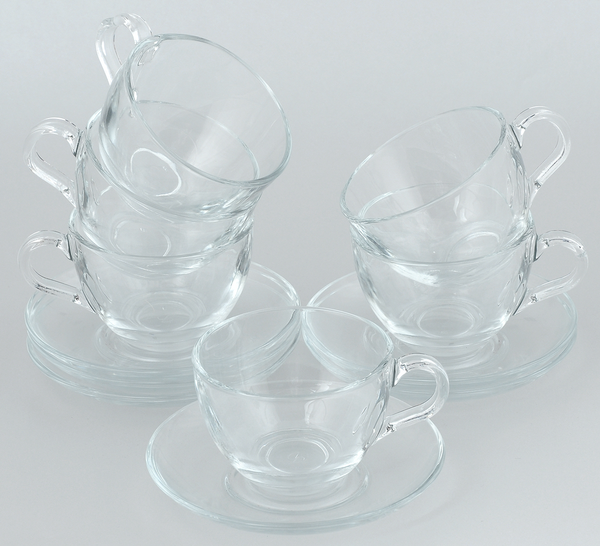 """Чайный набор Pasabahce """"Basic"""" состоит из шести чашек и шести блюдец. Предметы набора изготовлены из прочного натрий-кальций-силикатного стекла. Изящный чайный набор великолепно украсит стол к чаепитию и порадует вас и ваших гостей ярким дизайном и качеством исполнения.Объем чашки: 215 мл.Высота чашки: 6,5 см.Диаметр чашки: 9 см.Диаметр блюдца: 13,5 см."""