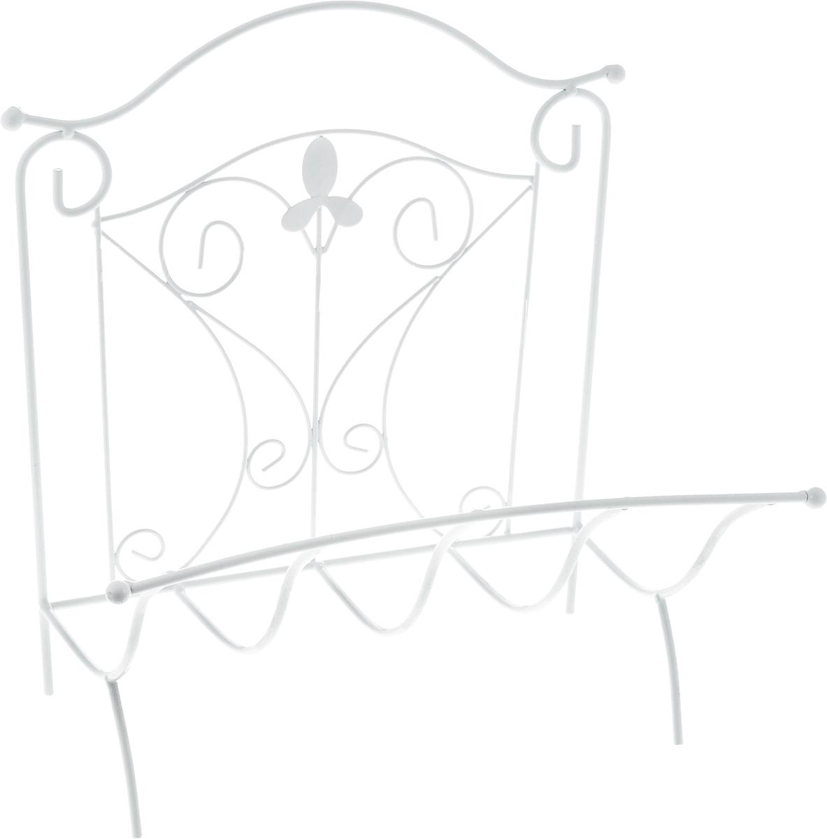 Подставка для газет Magic Home Французская лилия, 39 х 31 х 39 см44165Удобная подставка Magic Home Французская лилия предназначена для хранения газет и журналов. Изделие выполнено из кованого металла в классическом стиле. Изделие украшено изящными завитками и цветком из металла. Подставка располагается на удобных металлических ножках. Такая подставка поможет не только хранить газеты и журналы в одном месте, но и станет предметом декора.Размер подставки: 39 х 31 х 39 см.