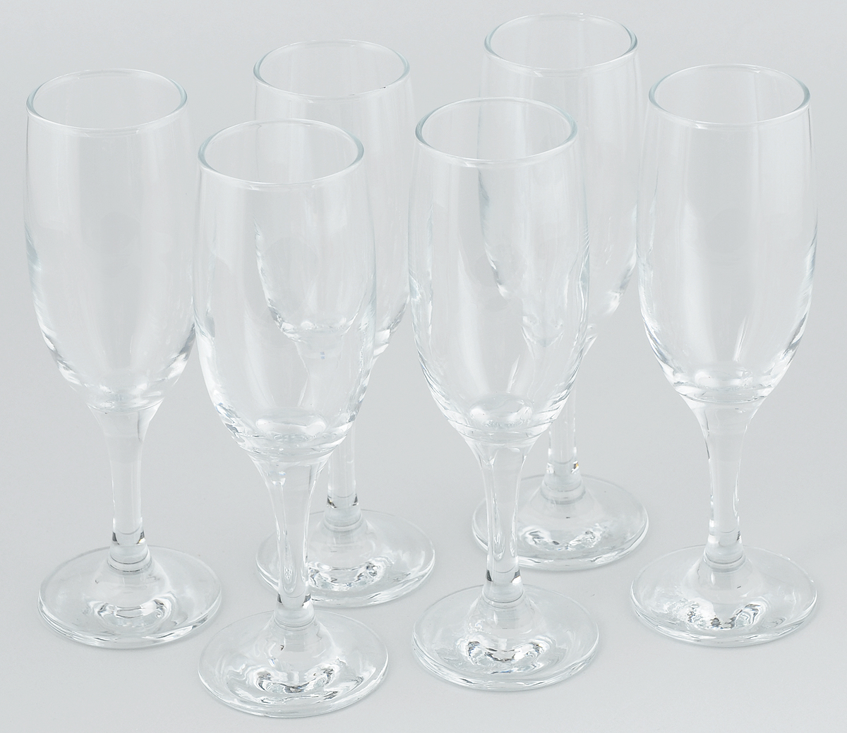 """Набор Pasabahce """"Bistro"""" состоит  из шести классических фужеров, выполненных из  прочного стекла. Изделия  оснащены высокими ножками и предназначены  для подачи шампанского. Они сочетают в себе элегантный дизайн и  функциональность. Набор фужеров Pasabahce """"Bistro"""" прекрасно  оформит праздничный стол  и создаст приятную атмосферу за  романтическим ужином. Такой набор также станет  хорошим подарком к любому случаю.  Высота бокала: 20 см."""