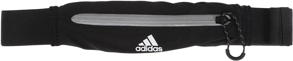 Сумка поясная для бега Adidas Run Belt, цвет: черный, белый, серыйS96357Сумка Adidas Run Belt выполнена из нейлона и эластана, оформлена символикой бренда.Сумка фиксируется на поясе с помощью застежки-фастекс. Сумка имеет удобный карман для мелочей на застежке-молнии, таких как ключи или деньги. Изделие оснащено светоотражающими деталями.Такая поясная сумка для бега станет настоящей находкой как для любителей, так и для профессиональных спортсменов, которые действительно серьезно подходят к экипировке.Длина пояса (с учетом сумки): 45-82 см.
