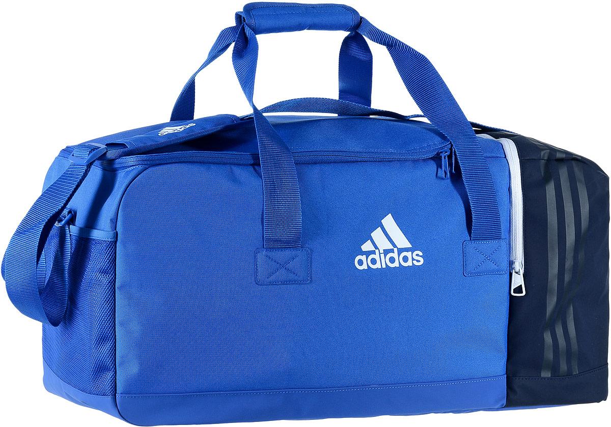 Сумка спортивная Adidas Tiro TB, цвет: темно-синий, голубой, 60 х 27 х 27 смB46127Стильная спортивная сумка Adidas Tiro TB выполнена из полиэстера и полиэфира. Изделие имеет одно отделение, закрывающееся на застежку-молнию. Внутри расположены два накладных открытых кармана и нашивной карман на застежке-молнии. Снаружи, с одной из боковых сторон находится вентилируемый карман для обуви на застежке-молнии, с другой стороны - сетчатый карман. Основание изделия выполнено из более плотного материала с полиуретановым покрытием, что обеспечивает защиту от влаги и дополнено пластиковыми ножками. Сумка оснащена двумя удобными ручками для переноски в руках и регулируемым наплечным ремнем.
