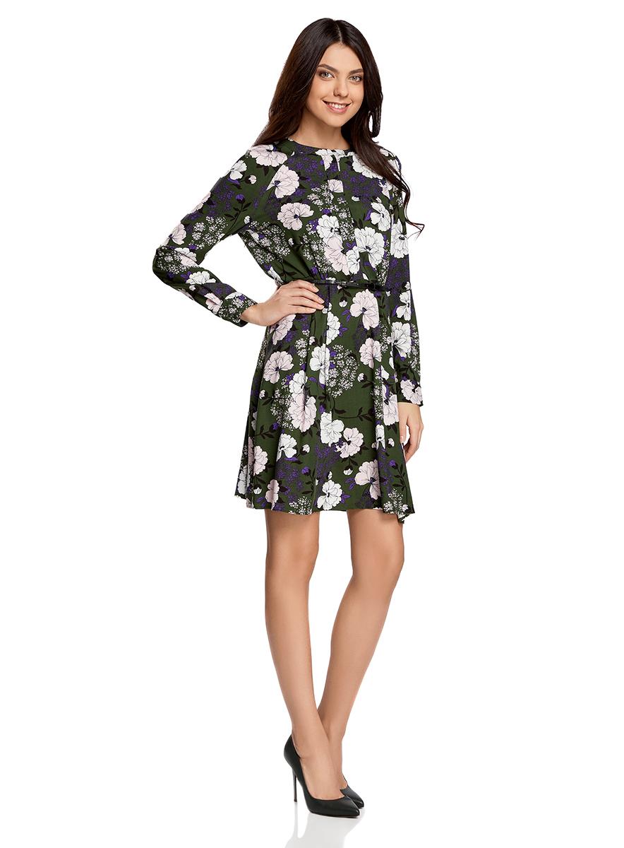 Платье oodji Collection, цвет: темно-зеленый, светло-розовый. 21912001-2/26346/6940F. Размер 42-170 (48-170)21912001-2/26346/6940FПлатье oodji Collection свободного кроя выполнено из легкой воздушной ткани с оригинальным цветочным узором. Модель средней длины с круглым вырезом горловины и длинными рукавами-реглан застегивается спереди и на манжетах на пуговицы; сбоку имеется скрытая застежка-молния.В комплект с платьемвходит узкий ремень из искусственной кожи с металлической пряжкой.
